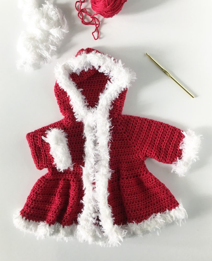 Christmas Baby Sweater - Here are 13 free crochet sweater patterns for the holiday season, including adorable outfits for baby, and out-of-this-world ugly Christmas sweaters! #freecrochetsweaterpatterns #crochetpatterns #crochetsweaters