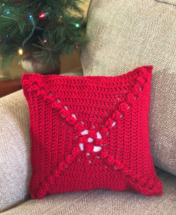Crochet Christmas Pillow - This list of free crochet patterns has some fun Christmas decorations that will deck your halls and bring jolly to your days! #crochetpatterns #christmascrochetpatterns #holidaycrochetpatterns