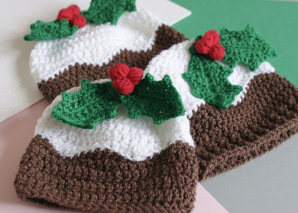 Crochet Christmas Pudding Beanie Hat with Holly Berries - This list of free crochet patterns has some fun Christmas decorations that will deck your halls and bring jolly to your days! #crochetpatterns #christmascrochetpatterns #holidaycrochetpatterns
