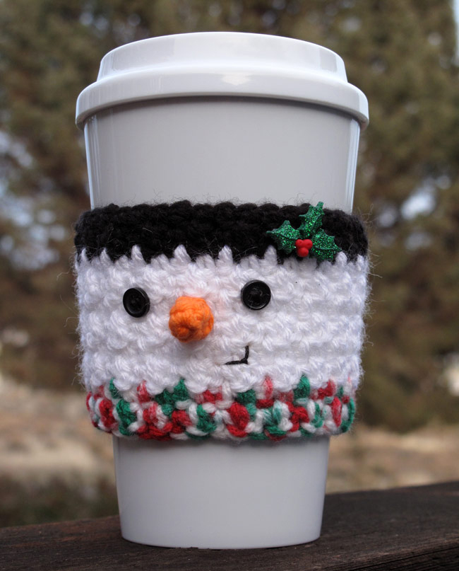 Crochet Snowman Coffee Cup Cozy - This list of free crochet patterns has some fun Christmas decorations that will deck your halls and bring jolly to your days! #crochetpatterns #christmascrochetpatterns #holidaycrochetpatterns