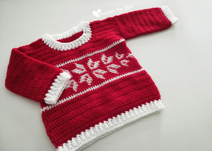 Winter Snowflake Baby Sweater - Here are 13 free crochet sweater patterns for the holiday season, including adorable outfits for baby, and out-of-this-world ugly Christmas sweaters! #freecrochetsweaterpatterns #crochetpatterns #crochetsweaters