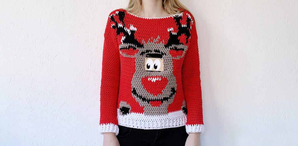 Digital Reindeer Christmas Sweater - Here are 13 free crochet sweater patterns for the holiday season, including adorable outfits for baby, and out-of-this-world ugly Christmas sweaters! #freecrochetsweaterpatterns #crochetpatterns #crochetsweaters