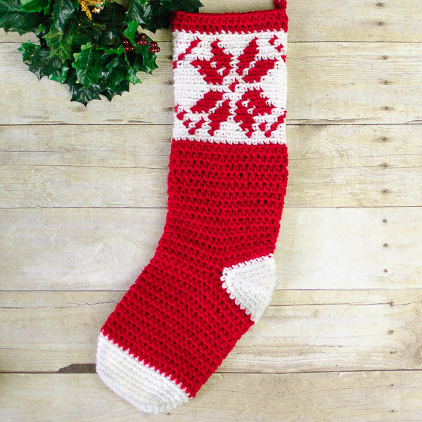 Fair Isle Snowflake Christmas Stocking - This list of free crochet patterns has some fun Christmas decorations that will deck your halls and bring jolly to your days! #crochetpatterns #christmascrochetpatterns #holidaycrochetpatterns