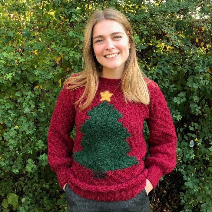 Johanna Christmas Sweater - Here are 13 free crochet sweater patterns for the holiday season, including adorable outfits for baby, and out-of-this-world ugly Christmas sweaters! #freecrochetsweaterpatterns #crochetpatterns #crochetsweaters