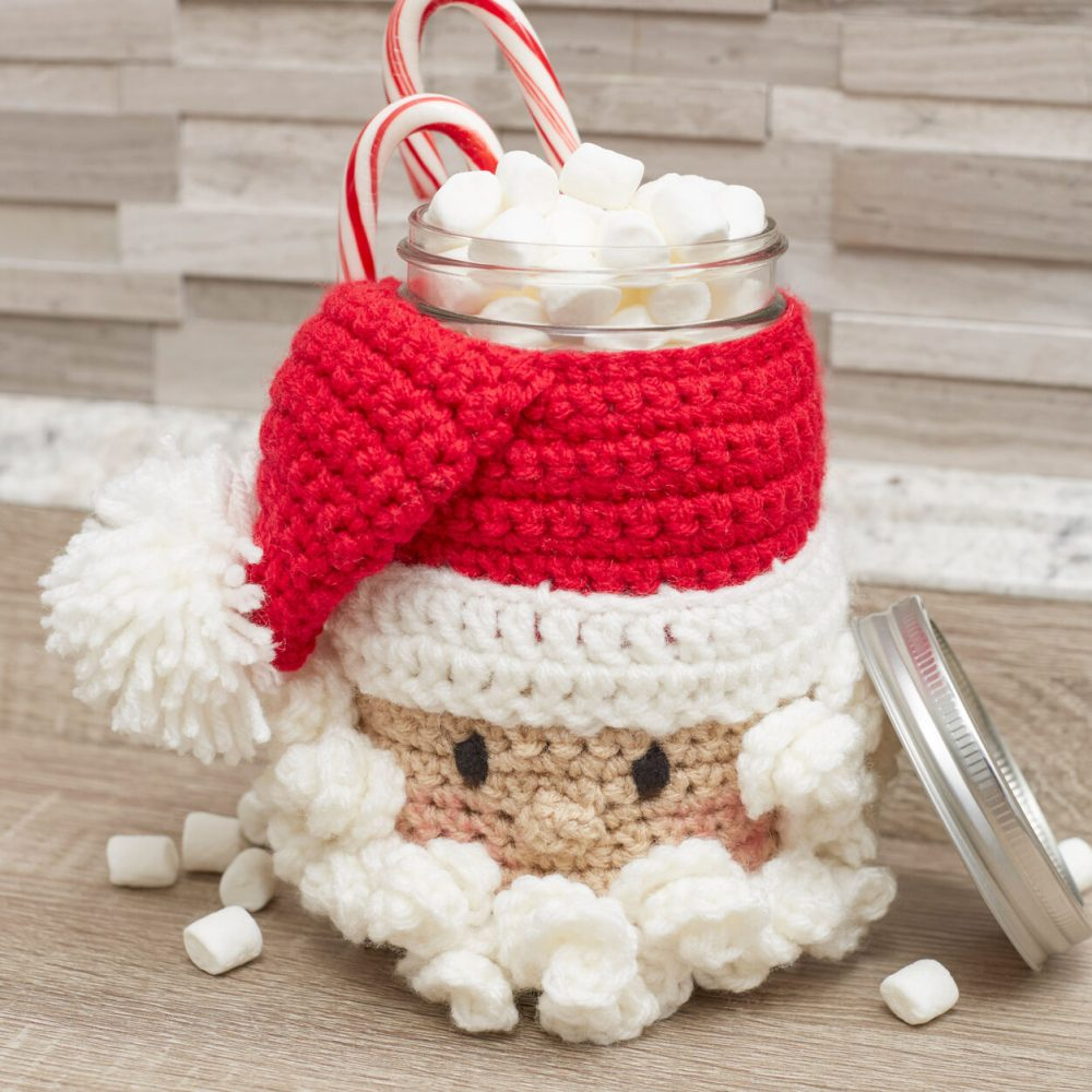 Red Heart Santa Candy Jar - This list of free crochet patterns has some fun Christmas decorations that will deck your halls and bring jolly to your days! #crochetpatterns #christmascrochetpatterns #holidaycrochetpatterns