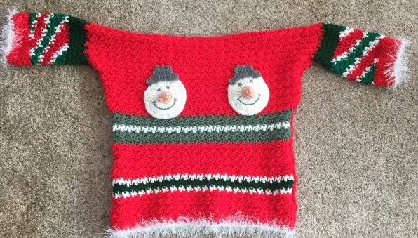 Ugly Christmas Sweater - Here are 13 free crochet sweater patterns for the holiday season, including adorable outfits for baby, and out-of-this-world ugly Christmas sweaters! #freecrochetsweaterpatterns #crochetpatterns #crochetsweaters