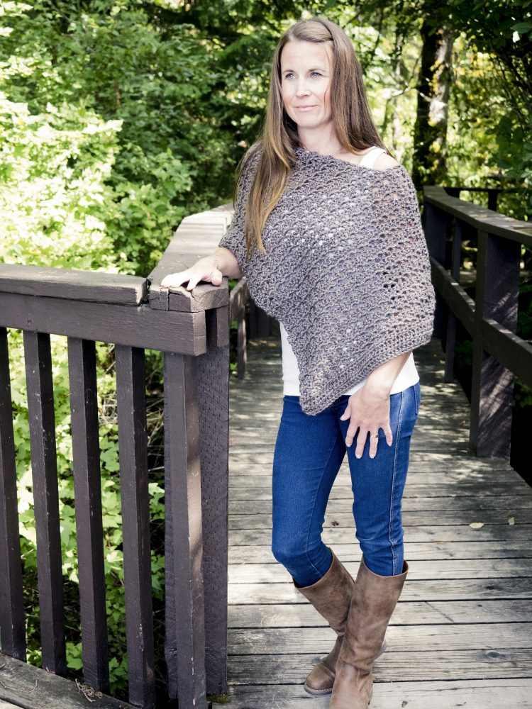 Asymmetrical Poncho - These free crochet poncho patterns may be used this winter, but many of the designs here can also work up to spring and even on a cool summer day! #freecrochetponchopatterns #crochetponcho #crochetpatterns