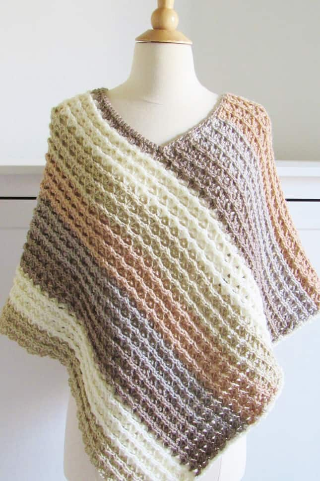 Sunset Poncho - These free crochet poncho patterns may be used this winter, but many of the designs here can also work up to spring and even on a cool summer day! #freecrochetponchopatterns #crochetponcho #crochetpatterns