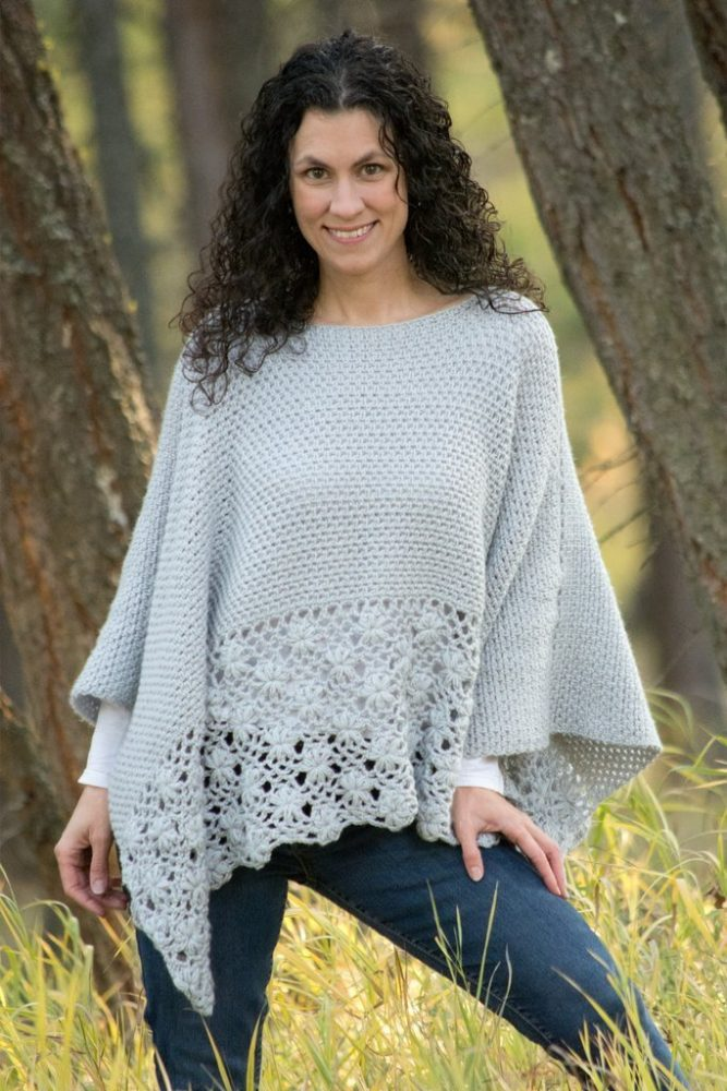 The Frosted Petals Poncho - These free crochet poncho patterns may be used this winter, but many of the designs here can also work up to spring and even on a cool summer day! #freecrochetponchopatterns #crochetponcho #crochetpatterns