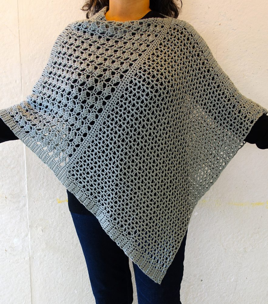 Wrapped Pearl Poncho - These free crochet poncho patterns may be used this winter, but many of the designs here can also work up to spring and even on a cool summer day! #freecrochetponchopatterns #crochetponcho #crochetpatterns